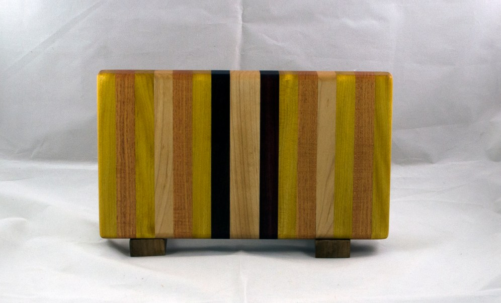 "Small Board 17 - 221. Yellowheart, Honey Locust, Hard Maple & Purpleheart. 7"" x 12"" x 1-1/8""."