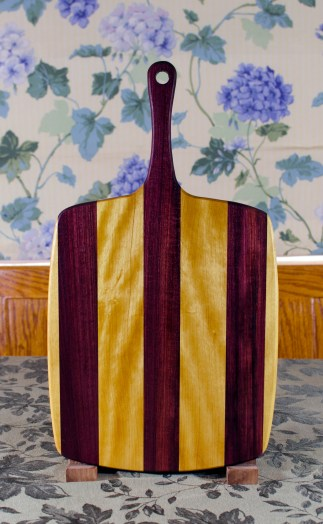 "Sous Chef 17 - 913. Yellowheart & Purpleheart. Large size, with the work space approximately 11"" x 15"", with the handle extending for an additional 6""."