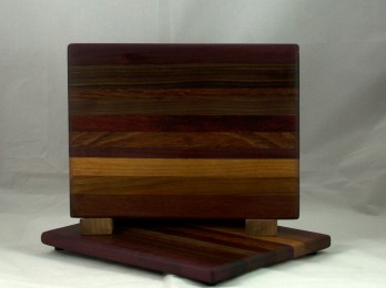 """Cheese Board 17 - 327. This chaos board has the most disappointing photograph of the bunch; this pic just doesn't do justice to the dark blend of 9 woods featured. 8"""" x 11"""" x 3/4""""."""