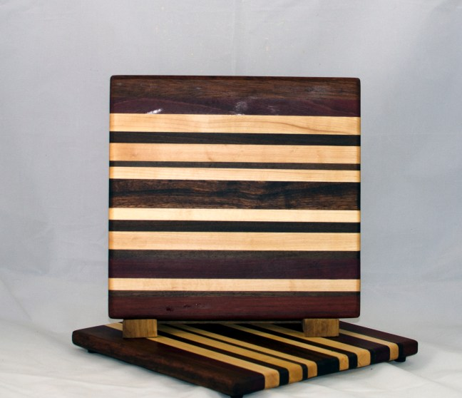 "Cheese Board 17 - 328. Purpleheart, Hard Maple, Sapele, Caribbean Rosewood & Bubinga. 9"" x 11"" x 3/4""."