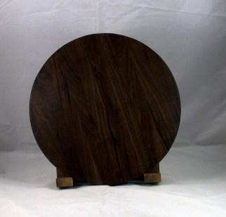 "Serving Piece 17 - 802. Black Walnut. 14"" diameter, 1-1/8"" thick. Urethane finish."