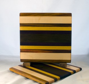 "Cheese Board 17 - 329. Canarywood, Hard Maple, Yellowheart & Caribbean Rosewood. 8"" x 11"" x 5/8""."
