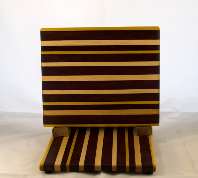 "Cheese Board 17 - 336. Yellowheart, Purpleheart, Hard Maple, Bubinga & Bloodwood. 9"" x 11"" x 5/8""."