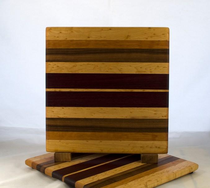 "Cheese Board 17 - 338. Birds Eye Maple, Cherry, Black Walnut, Yellowheart & Purpleheart. 10"" x 11"" x 5/8""."