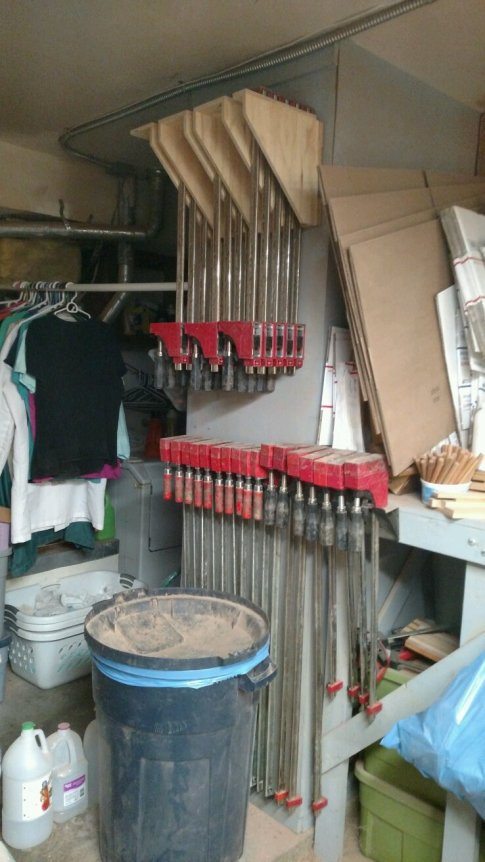 The top clamp storage rack was added to my original rack, behind the trash can, to solve almost all of my clamp storage needs. That's great ... I now enough clamps to do 13 simultaneous sets of glue-ups, which is about right for my shop.