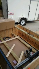 Boxes removed; only the CNC remains in the crate.