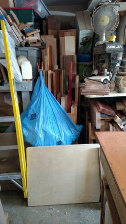 """A great representation of my chaos. A ladder, a bag of recycling, lumber storage, finished product and a plywood piece, all within 24"""" of each other. Not. Good."""
