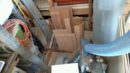 Lumber storage, in this case behind the router table. This has got to go to clear floor space for the new tool.