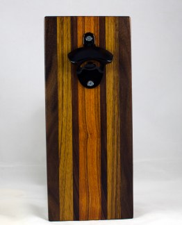Magic Bottle Opener 17 - 65. Black Walnut, Teak, Purpleheart & Canarywood. Double Magic - means it can fridge mount or wall mount.