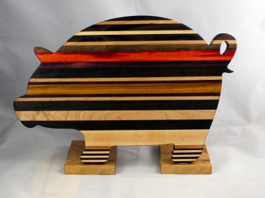 "Pig 17 - 710. Black Walnut, Cherry, Hard Maple, Padauk, Canarywood, Jatoba, Purpleheart. 12"" x 19"" x 1-1/8""."