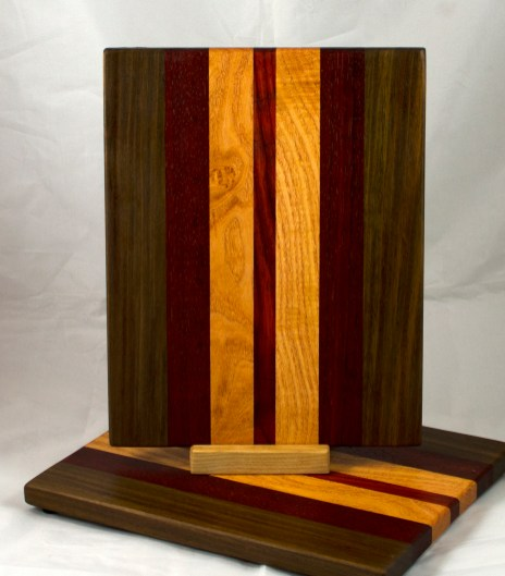 "Cheese Board 17 - 346. Black Walnut, Padauk & Honey Locust. 9"" x 11"" x 3/4""."