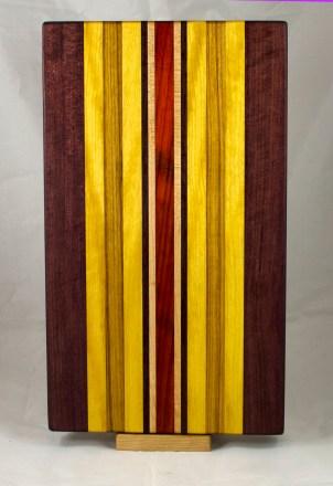 "Cutting Board 17 - 146. Purpleheart, Yellowheart, Canarywood, Hard Maple & Padauk. 12"" x 20"" x 1-1/4""."