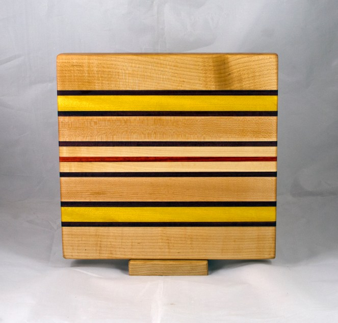 "Small Board 17 - 243. Hard Maple, Purpleheart, Yellowheart & Padauk. 10"" x 11"" x 1""."