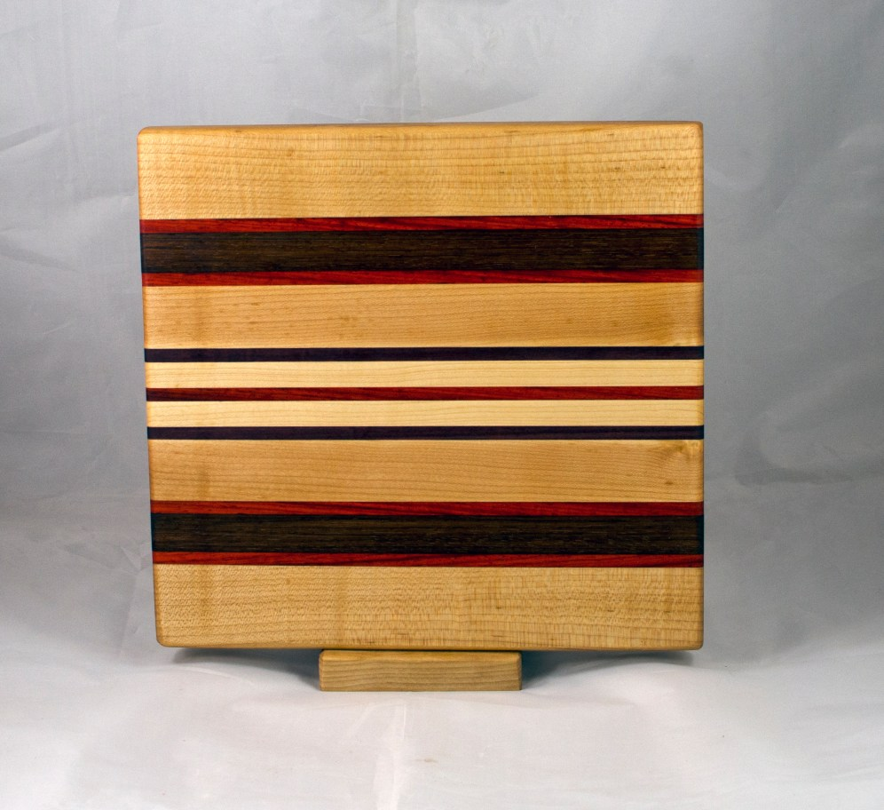 "Small Board 17 - 246. Hard Maple, Padauk & Purpleheart. 10"" x 11"" x 1""."
