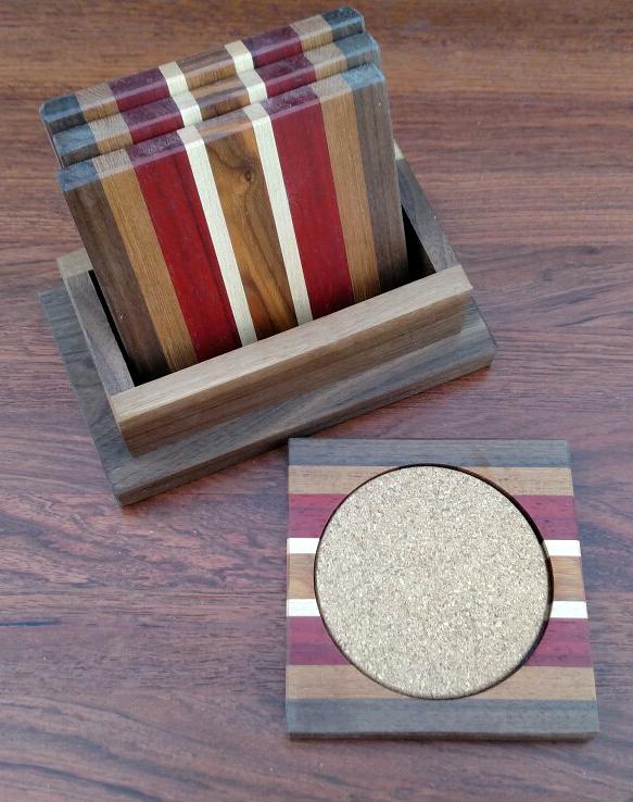 Coasters 18 - 02. Black Walnut, Jatoba, Padauk, Hard Maple, Morado & Cork. Shown with Black Walnut holder.
