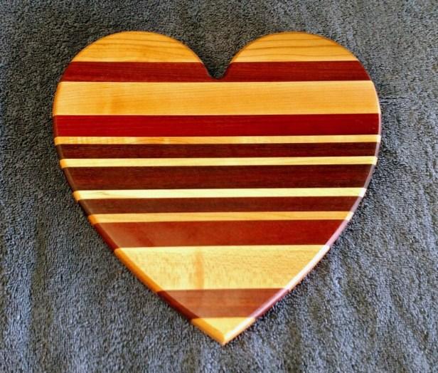 "Heart 18 - 906. Hard Maple, Bubinga, Purpleheart & Bloodwood. Jatoba, 11"" x 11"" x 3/4""."