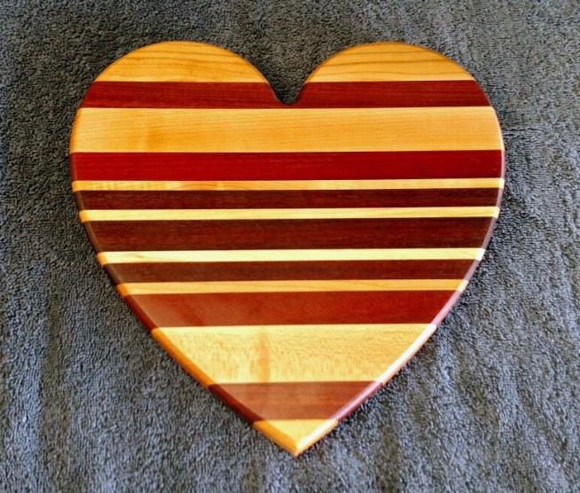 "Heart 18 - 906. Hard Maple, Bubinga, Purpleheart & Bloodwood. Jatoba, 11"" x 11"" x 3/4""."
