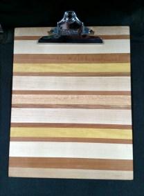 "Clipboard 18 - 802. Letter Size. Hard Maple, Cherry, Yellowheart & Honey Locust. 1"" clip."