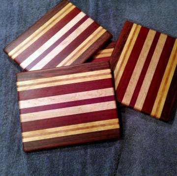 "Cheese Board 18 - 117. Jatoba, Yellowheart, Cherry, Padauk & Purpleheart. 9"" x 11"" x 5/8""."