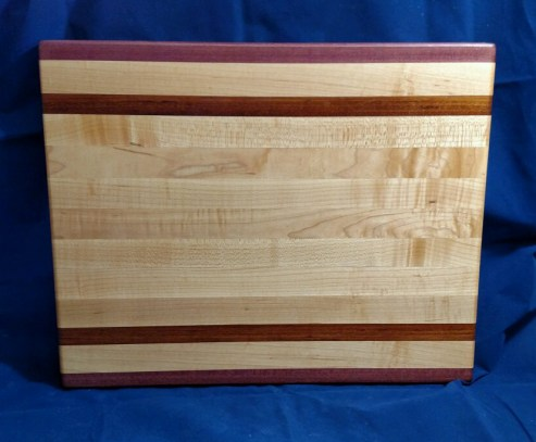"Cutting Board 18 - 315. Purpleheart, Hard Maple & Jatoba. 14"" x 18"" x 1-1/8"". Edge grain."