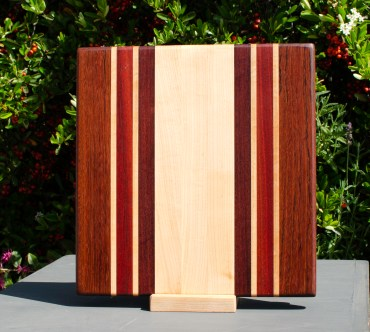 "Small Board 18 - 205. Jatoba, Hard Maple, Bloodwood & Bubinga. 12"" x 12"" x 1""."