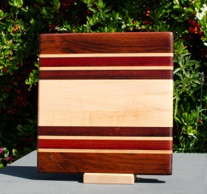 "Small Board 18 - 206. Jatoba, Hard Maple, Bloodwood & Bubinga. 12"" x 12"" x 1"". Commissioned piece."