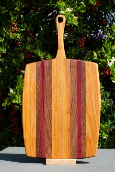 "Sous Chef 18 - 702. Canarywood, Black Walnut & Purpleheart. 11"" x 20"" x 3/4""."