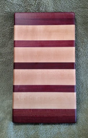 "Small Board 18 - 208. Purpleheart, Hard Maple & Bloodwood. 7"" x 12"" x 1-1/8""."
