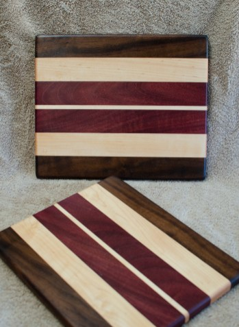 "Cheese Board 18 - 120. Black Walnut, Hard Maple & Purpleheart. 9"" x 11"" x 5/8""."