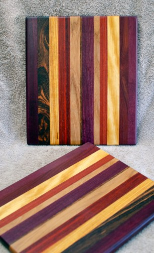 "Cheese Board 18 - 122. Purpleheart, Yellowheart, Padauk, Cherry, Goncalo Alves & Canarywood. 9"" x 11"" x 5/8""."
