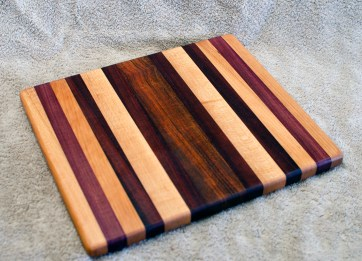 "Cheese Board 18 - 125. Hard Maple, Purpleheart, Cherry, Jatoba & Bloodwood. 10"" x 11"" x 3/4""."