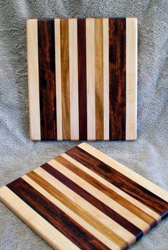 "Cheese Board 18 - 126. Hard Maple, Bubinga, Canarywood & Bloodwood. 9"" x 11"" x 5/8""."