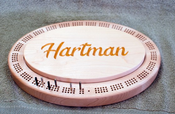 Cribbage 18 - 05. Hard Maple. Carved name is backfilled with gold acrylic.