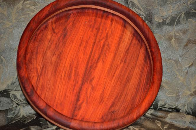 Padauk is photo-reactive. Over time, UV light will change the bright orange to a warm brown. Better keep it in the dark until Hallowe'en!