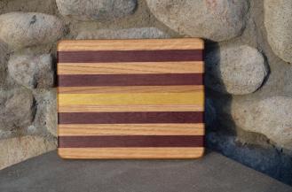 # 8 Cheese Board, $30. Red Oak, Walnut, Yellowheart.