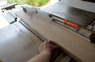 Here's a properly straightened board, with that new straight edge up against the fence of the table saw.