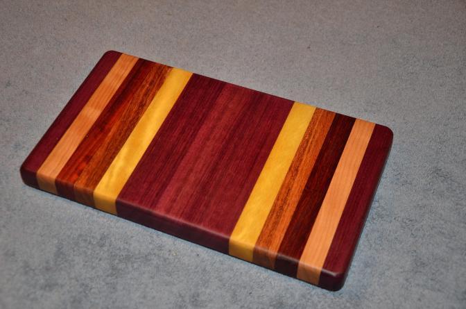 """Small Board # 15 - 015. Purpleheart, Cherry, Padauk, Jatoba and Yellowheart. 7"""" x 12"""" x 1-1/4""""."""