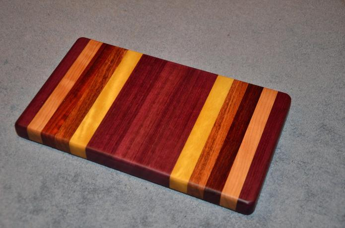 "Small Board # 15 - 015. Purpleheart, Cherry, Padauk, Jatoba and Yellowheart. 7"" x 12"" x 1-1/4""."