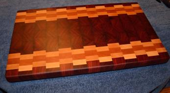 """Cutting Board # 15 - 024. Spectacular color and grain patterns make this a board a visual treat. Jarrah, Hard Maple and Cherry end grain. 13"""" x 19"""" x 1-1/2""""."""