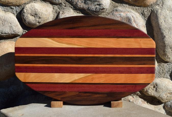 """Surfboard # 15 - 43. Black Walnut, Purpleheart & Curly Cherry. 12"""" x 19"""" x 1-1/4""""."""