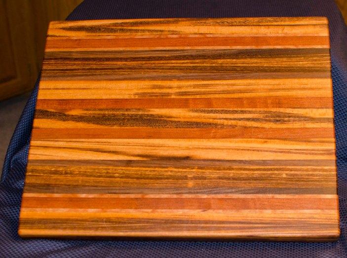 "Cutting Board 16 - Edge 003. Goncalo Alves, Jatoba, Black Walnut, Cherry. Edge Grain. 17"" x 21"" x 1-1/2"". Commissioned piece."