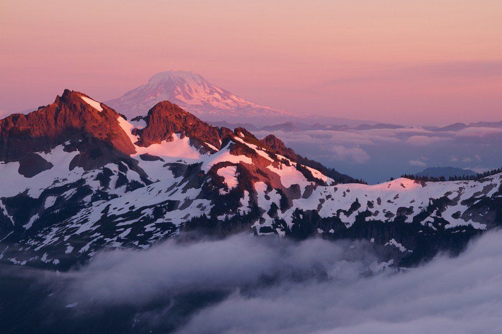 The last light of the day falls on the Tatoosh Mountains and Mount Adams, as seen from the Skyline Trail, Washington. Photo of by Justin Marx. Posted on Tumblr by the US Department of the Interior, 1/17/16.