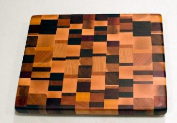 "Small Board 16 - 004. Black Walnut, Cherry, Hard Maple, Purpleheart, Burmese Teak, Yellowheart, Purpleheart, Padauk & Hickory. End Grain. 10"" x 12"" x 1""."