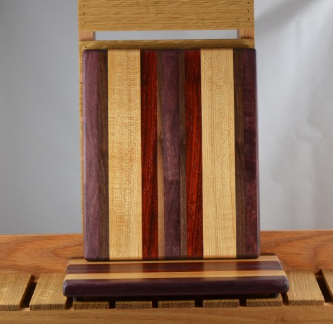 "Cheese Board 16 - 015. Purpleheart, Hard Maple, Padauk & Black Walnut. 8"" x 11"" x 3/4""."
