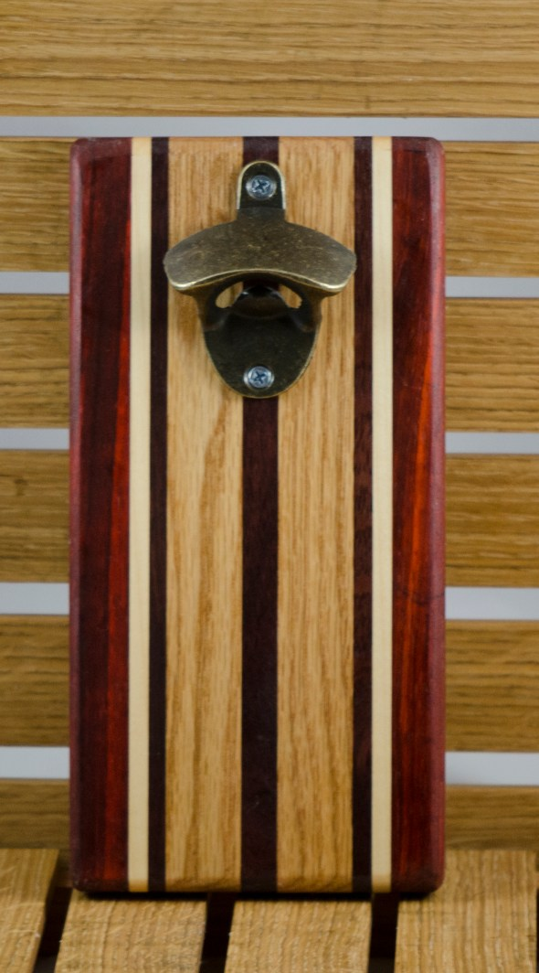 "Magic Bottle Opener 16 - 014. Wall mount. Padauk, Hard Maple, Red Oak & Black Walnut, Approximately 5"" x 10"" x 3/4""."