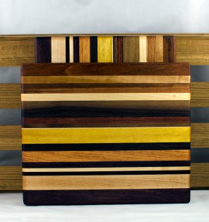 "Cheese Board 16 - 030. Chaos Board. Padauk, Cherry, Jatoba, Hard Maple, Black Walnut, Bloodwood, Yellowheart & Honey Locust. 9"" x 11"" x 3/4""."