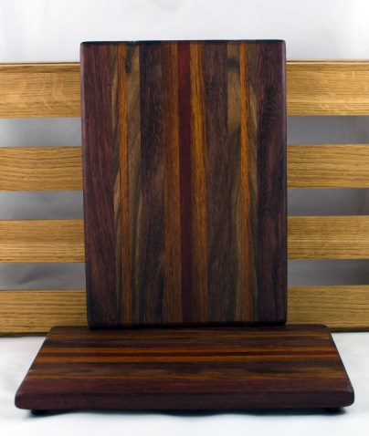 "Cheese Board 16 - 047. Purpleheart, Bloodwood, Jatoba, Black Walnut & Caribbean Rosewood. 7"" x 11"" x 3/4""."