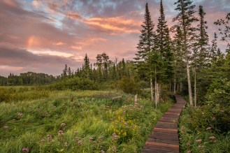 """Walk in the footsteps of fur traders and the Grand Portage Ojibwe at Grand Portage National Monument, located on the North Shore of Lake Superior in Minnesota next to the Canadian border. The 8.5-mile Grand Portage Trail winds through history and beautiful scenery like forests and meadows. After hiking through a downpour, photographer Travis Novitsky says, """"The gorgeous sunset over the beaver meadow made it all worthwhile!"""" Photo courtesy of Travis Novitsky. Posted on Tumblr by the US Department of the Interior, 9/1/16."""