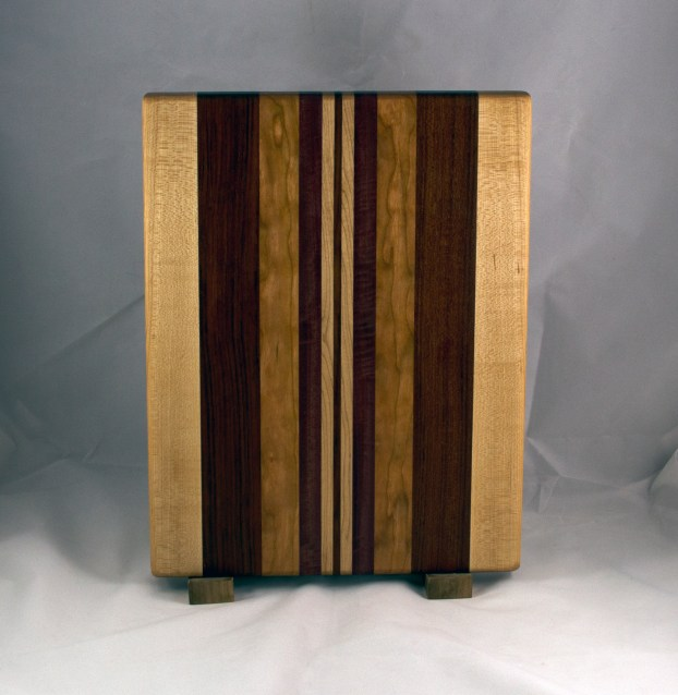 "Cutting Board 16 - Edge 026. Hard Maple, Bubinga, Cherry, Bloodwood & Purpleheart. Edge Grain. 12"" x 16"" x 1-1/4""."