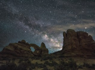 Arches National Park in Utah is the perfect place to snuggle into your sleeping bag and spend the night counting stars. Towering rock formations reach for the Milky Way as the magnificent landscape surrounds you in silence. Photo by Allen Utzig. Posted on Tumblr by the US Department of the Interior, 11/26/16.
